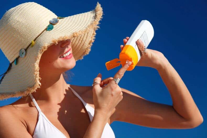 Woman With Hat Applying Sunscreen 3454286